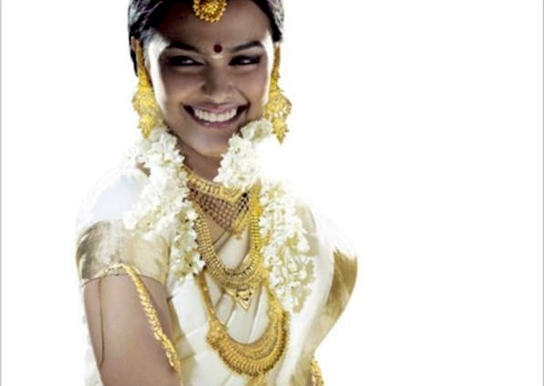 The traditional bridal dress consists of a two piece cream colour saree