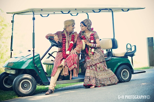 Indian couple in a buggie after their wedding
