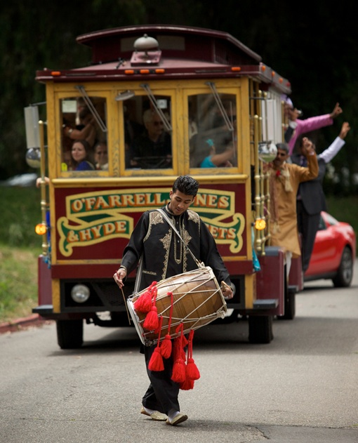 dhol player ahead of tram at Indian baraat