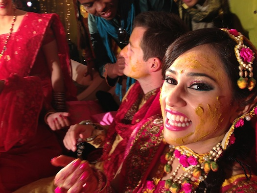 bengali bride with turmeric on face