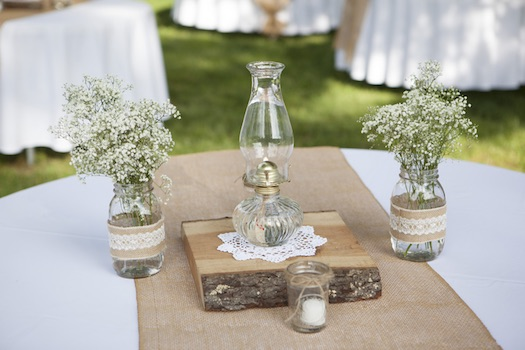 oil lantern at rustic wedding reception